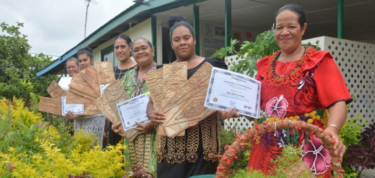 Women from kupesi making workshop holding their certificates