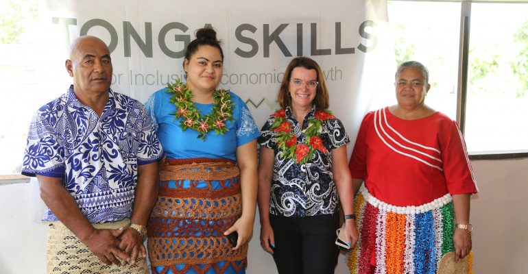 Group of four individuals standing in front of Tonga Skills sign: Senator Anne Ruston visited Kiko's Whale, Swim, Dive Lodge and Restaurant@ 'Eua island on March 11, 2019